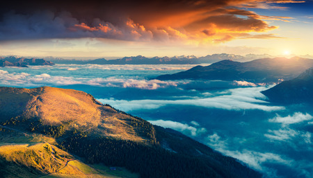 bolzano province: Colorful summer sunrise in Dolomite Alps. Morning view from Furchetta peak on Santa Magdalena village under a sea of fog. Province of Bolzano, South Tyrol, Italy. Stock Photo
