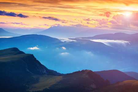 bolzano province: Colorful summer sunset in the Dolomite Alps. Evening view from Furchetta peak on Santa Magdalena village. Province of Bolzano, South Tyrol, Italy. Stock Photo
