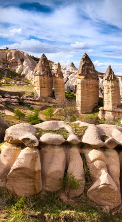 sublime: Amazing shapes in sandstone canyon near famous Goreme village, Cappadocia, district of Nevsehir Province in the Central Anatolia Region of Turkey, Asia. Artistic style post processed photo.