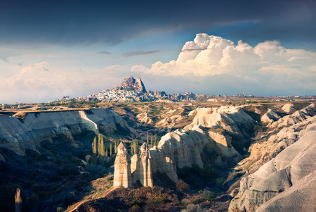 sublime: April morning in canyon near the famous Cappadocia village Uchisar, district of Nevsehir Province in the Central Anatolia Region of Turkey, Asia. Artistic style post processed photo. Stock Photo