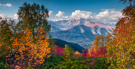 Colorful autumn landscape in the Caucasus mountains. Sunny morning scene with mountain Ushba on the background. Mkheer, Svaneti, Georgia, Europe. Artistic style post processed photo. Stock Photo