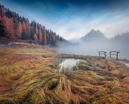 Misty outdoor scene on Antorno lake. Colorful autumn morning in Dolomite Alps, National Park Tre Cime di Lavaredo, Italy, Europe. Stock Photo