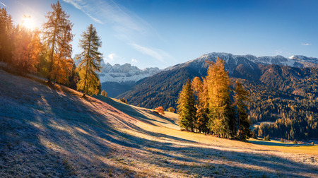Panorama of the Santa Maddalena villages slopes in front of the Geisler or Odle Dolomites Group. Colorful autumn sunrise in Dolomite Alps, Italy, Europe.