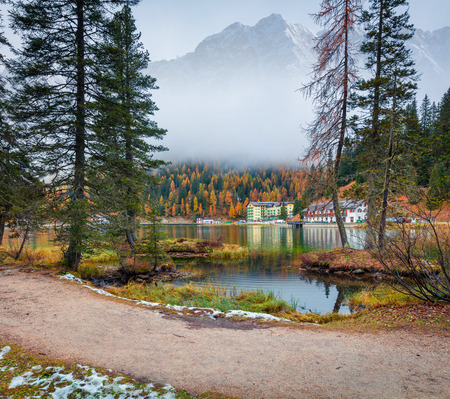 Foggy morning scene on Misurina lake in National Park Tre Cime di Lavaredo. Colorful autumn landscape in Dolomite Alps, South Tyrol, Location Auronzo, Italy, Europe. Artistic style post processed photo. Stock Photo