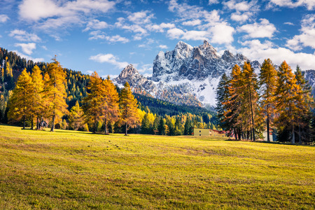 bolzano province: Sunny view of Durrenstein mountain from Vallone village. Colorful autumn scene in the Dolomite Alps, Province of Bolzano - South Tyrol, Itale, Europe.