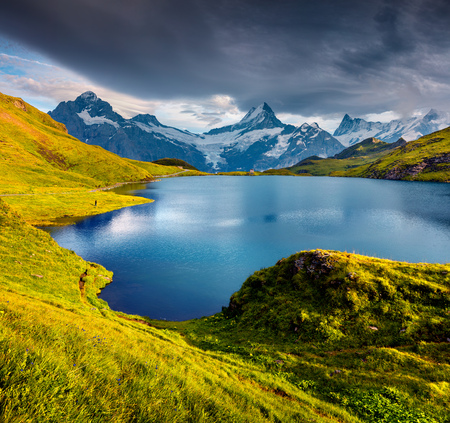the bernese oberland: Wetterhorn and Wellhorn peaks over Bachsee lake. Colorful summer scene in Bernese Oberland Alps, Grindelwald location, Innertkirchen, Switzerland, Europe. Stock Photo