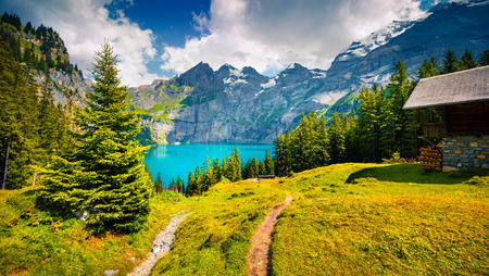 the bernese oberland: Colorful summer morning on unique lake - Oeschinen (Oeschinensee). Beautiful outdoor scene in Bernese Oberland Alps, Switzerland, Europe.