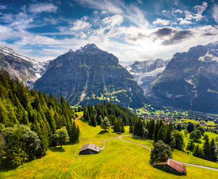 the bernese oberland: Colorful morning view of Grindelwald village valley from cableway. Wetterhorn mountain, located west of Innertkirchen in the Bernese Oberland Alps. Switzerland, Europe. Stock Photo