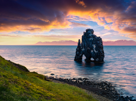 Huge basalt stack Hvtserkur on the eastern shore of the Vatnsnes peninsula. Colorful summer sunrise in northwest Iceland, Europe. Artistic style post processed photo. Stock Photo