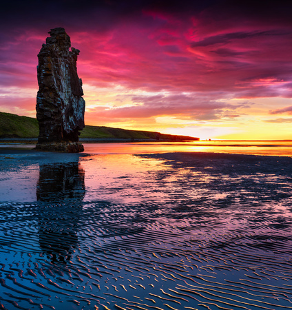 Huge basalt stack Hvitserkur on the eastern shore of the Vatnsnes peninsula. Colorful summer sunrise in northwest Iceland, Europe. Artistic style post processed photo.