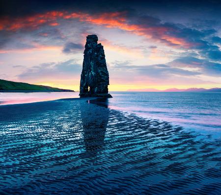 Huge basalt stack Hvtserkur on the eastern shore of the Vatnsnes peninsula. Colorful summer sunrise in northwest Iceland, Europe. Artistic style post processed photo. Stock Photo