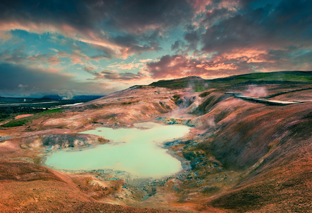 Boiling water lake in the Krafla volcano. Colorful exotic sunset with lava ground in the geothermal valley Leirhnjukur, located near Lake Myvatn in north of Iceland, Europe. Artistic style post processed photo. Stock Photo
