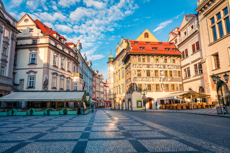 Sunny morning in the splendid street of Prague. Colorful spring cityscape of  Old Town square with street cafes, Czech Republic - Prague, Europe. Artistic style post processed photo.