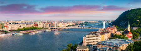 Panoramic cityscape of Pest city with Elisabeth Bridge on the Danube river. Colorful spring sunset in Budapest, Hungary, Europe. Artistic style post processed photo.
