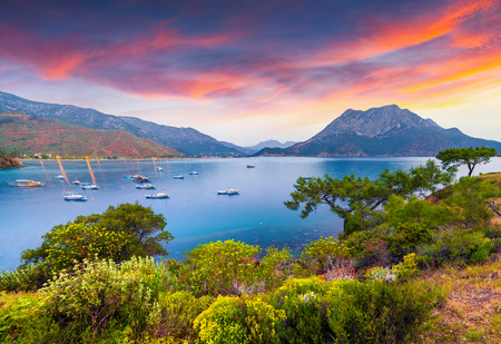 Picturesque Mediterranean seascape in Turkey. Colorful spring sunrise in Adrasan bay with view of Moses Mountain. District of Kemer, Antalya Province. Artistic style post processed photo. Stockfoto