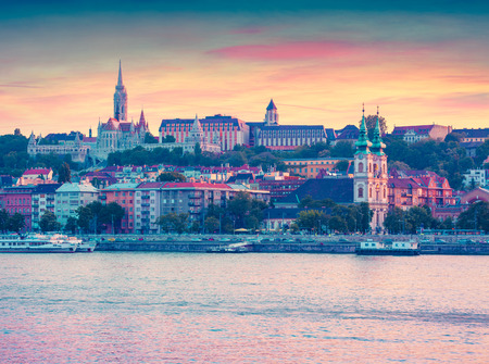 Evening view of  Fishermans Bastion and Szent Ferenc sebei templon. Colorful spring scene in Budapest, capital of Hungary, Europe. Instagram toning effect.