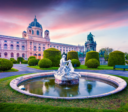 Colorful sunset in Maria Theresa Square with famous Naturhistorisches Museum (Natural History Museum) and fountain. Beautifu outdoor scene in Vienna, Austria, Europe. Artistic style post processed photo.
