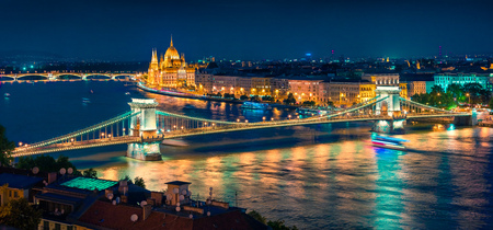 Night view of Parliament and Chain Bridge in Pest city. Colorful evening cityscape of Budapest, Hungary, Europe. Artistic style post processed photo. Banco de Imagens