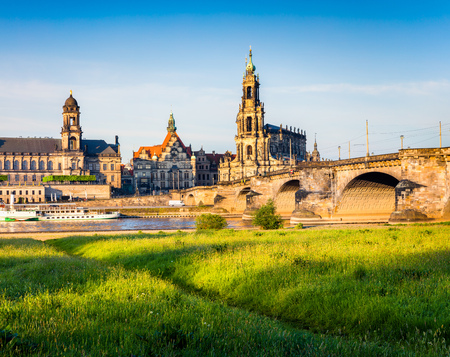 Morning view of Cathedral of the Holy Trinity or Hofkirche, Bruehls Terrace or The Balcony of Europe. Colorful spring scene on Elbe river in Dresden, Saxony, Germany, Europe. Stock Photo