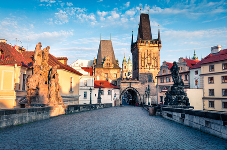 Sunny spring scene on Charles bridge on Vltava river (Karluv Most) with statues and Prague castle. Colorful morning cityscape in Prague, Czech Republic, Europe. Artistic style post processed photo. Stock Photo