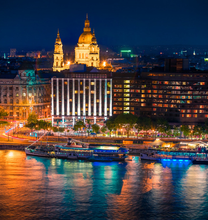 Picturesque cityscape of centered Saint Stephens Basilica (St Istvans) church and Danube river. Colorful night scene in Budapest, Hungary, Europe. Artistic style post processed photo.