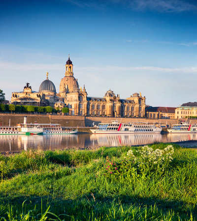 Morning view of Academy of Fine Arts and Baroque church Frauenkirche cathedral. Colorful spring scene on Elbe river in Dresden, Saxony, Germany, Europe. Artistic style post processed photo. Stock Photo