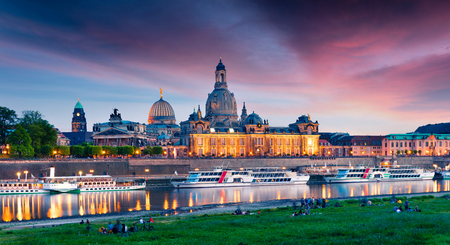 Evennig view of Academy of Fine Arts and Baroque church Frauenkirche cathedral. Colorful sunset on Elbe river in Dresden, Saxony, Germany, Europe. Artistic style post processed photo. Stock Photo
