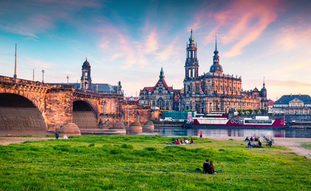 museum visit: Evennig view of Cathedral of the Holy Trinity or Hofkirche, Bruehls Terrace or The Balcony of Europe. Colorful sunset on Elbe river in Dresden, Saxony, Germany, Europe.