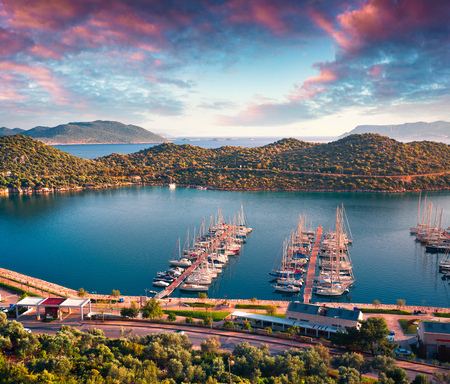View from the birds eye of the Kas city, district of Antalya Province of Turkey, Asia. Colorful spring sunset in small Mediterranean yachting and tourist town. Artistic style post processed photo.