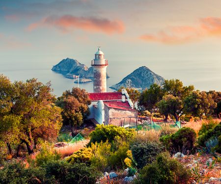 Lighthouse on Gelidonya peninsula in April. Colorful sunset in Turkey, Asia. Evening scene on Mediterranean sea. Artistic style post processed photo.