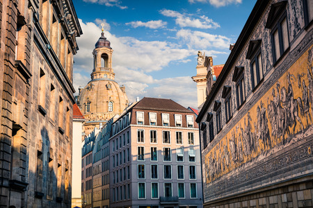 Sunny view of senter of Dresden with historic buildings and the Fuerstenzug (Procession of Princes), a giant mural. Summer morning in capital of Saxony, Germany, Europe. Artistic style post processed photo.