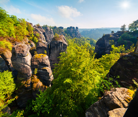 Misty morning on sandstone cliff in Saxon Switzerland National Park. Colorful spring landscape in Germany, Saxony, Europe. Artistic style post processed photo. Stock Photo