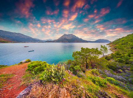 Picturesque Mediterranean seascape in Turkey. Colorful spring sunrise in Adrasan bay with view of Moses Mountain. District of Kemer, Antalya Province. Artistic style post processed photo. Stok Fotoğraf - 77994365