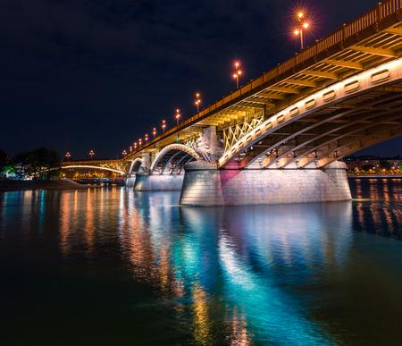 View of famous Margit or Margaret Bridge (sometimes Margit Bridge). Night scene in Budapest is World Heritage Site by UNESCO, Hungary, Europe. Artistic style post processed photo.
