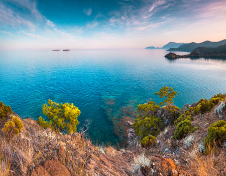 Picturesque Mediterranean seascape in Turkey. Colorful view of a small bay near the Tekirova village, District of Kemer, Antalya Province. Artistic style post processed photo. Stok Fotoğraf - 77888433