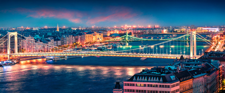 Panoramic cityscape of Pest city with Elisabeth Bridge on the Danube river. Colorful spring sunset in Budapest, capital of Hungary, Europe. Artistic style post processed photo.