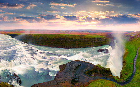 Huge waterfall Gullfoss in the morning mist. Colorful summer sunrise on Hvita river in southwest Iceland, Europe. Artistic style post processed photo.