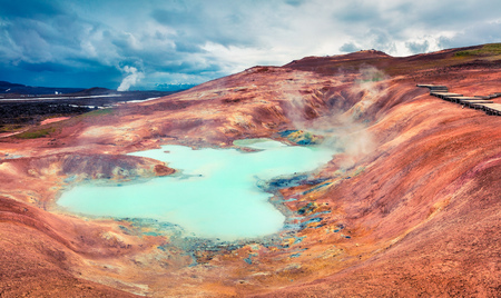 Boiling water lake in the Krafla volcano. Colorful exotic morning with lava ground in the geothermal valley Leirhnjukur, located near Lake Myvatn in north of Iceland, Europe. Stock Photo
