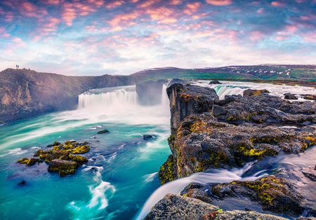 Summer morning scene on the Godafoss Waterfall. Colorful sunrise on the on Skjalfandafljot river, Iceland, Europe. Artistic style post processed photo.