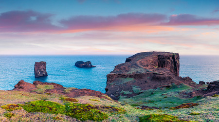 Splendid summer sunrise in Dyrholaey Nature Reserve. Great view of Dyrholaey arch, south coast of Iceland, Europe. Artistic style post processed photo. Stok Fotoğraf