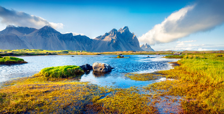 Colorful panorama of the Stokksnes headland on southeastern Icelandic coast with Vestrahorn (Batman Mountain). Iceland, Europe. Artistic style post processed photo. Stock Photo