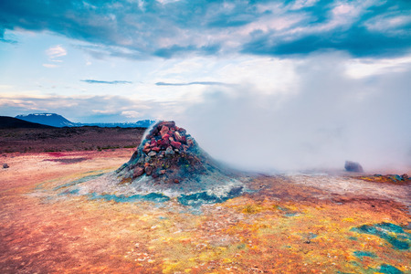 Steaming fumarole in geothermal valley Hverarond. Exotic summer landscape of volcanic Icelandic landmark, Reykjahlid village location, north Iceland, Europe. Artistic style post processed photo. Stock Photo