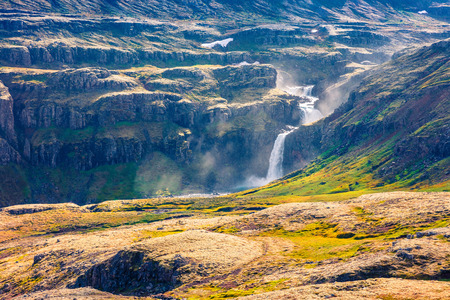 Typical Icelandic landscape in the mountains. Colorful summer morning with waterfall in the Iceland, Europe. Artistic style post processed photo.