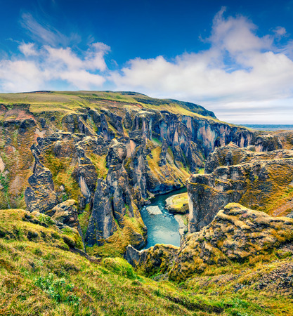 Picturesque view of Fjadrargljufur canyon and river. Colorful summer scene in South east Iceland, Europe. Artistic style post processed photo.
