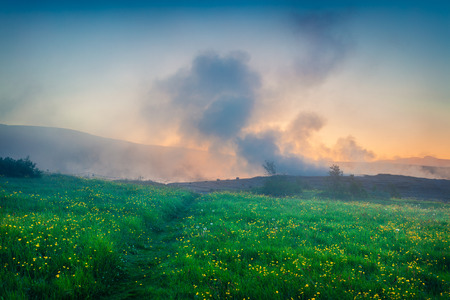 Foggy summer sunrise in Great Geysir valley, on the slopes of Laugarfjall hill. Colorful morning scene in Southwestern Iceland, Europe. Artistic style post processed photo.