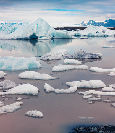Floating ice box on the Fjallsarlon glacial lagoon. Sunny morning scene in Vatnajokull National Park, southeast Iceland, Europe. Artistic style post processed photo. Stock Photo - 85313513