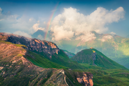 Summer evening view of Grossglockner mountain range from Grossglockner High Alpine Road with rainbow in the sky. Colorful sunset in Austrian Alps, Zell am See district, state of Salzburg in Austria Stock Photo - 87183460