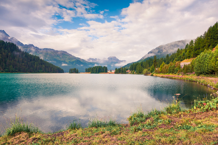 Sunny summer landscape of Silvaplana lake. Colorful morning view of Segl village, Maloja pass, Upper Engadine in the Swiss canton of the Grisons, Switzerland