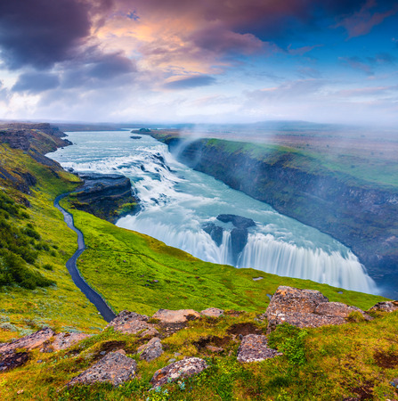 Huge waterfall Gullfoss in the morning mist. Colorful summer sunrise on Hvita river in southwest Iceland