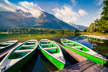 Colorsul summer morning on the Hintersee lake with white pleasure launches. Splendid morning scene in Austrian Alps. Salzburg-Umgebung, Austria Stock Photo